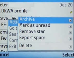 The GMail client menu, showing Archive, mark as unread, remove star, report spam and delete, each with keys attached.