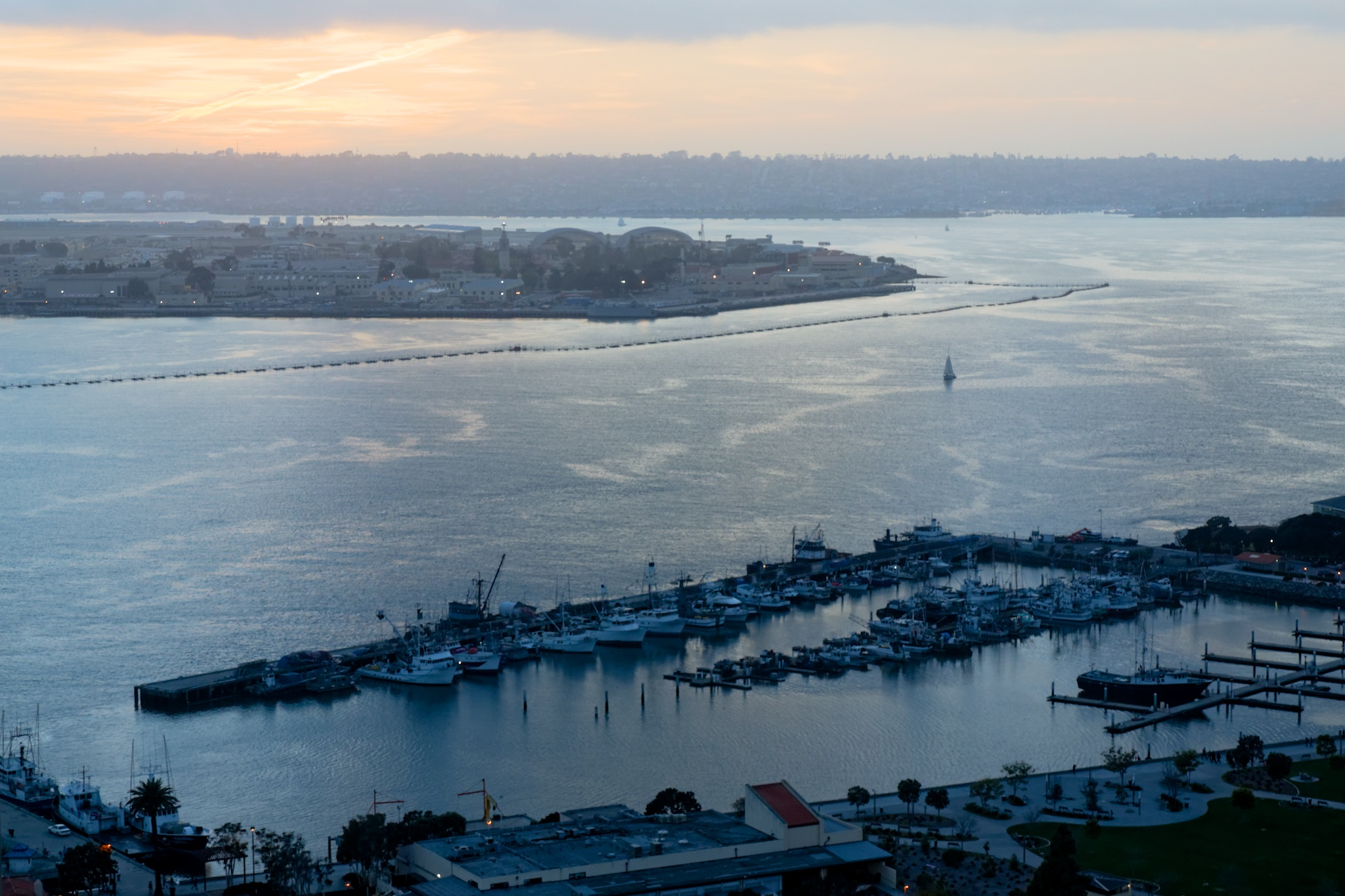 Sunset over San Diego harbour, lovely orange colours over grey water.
